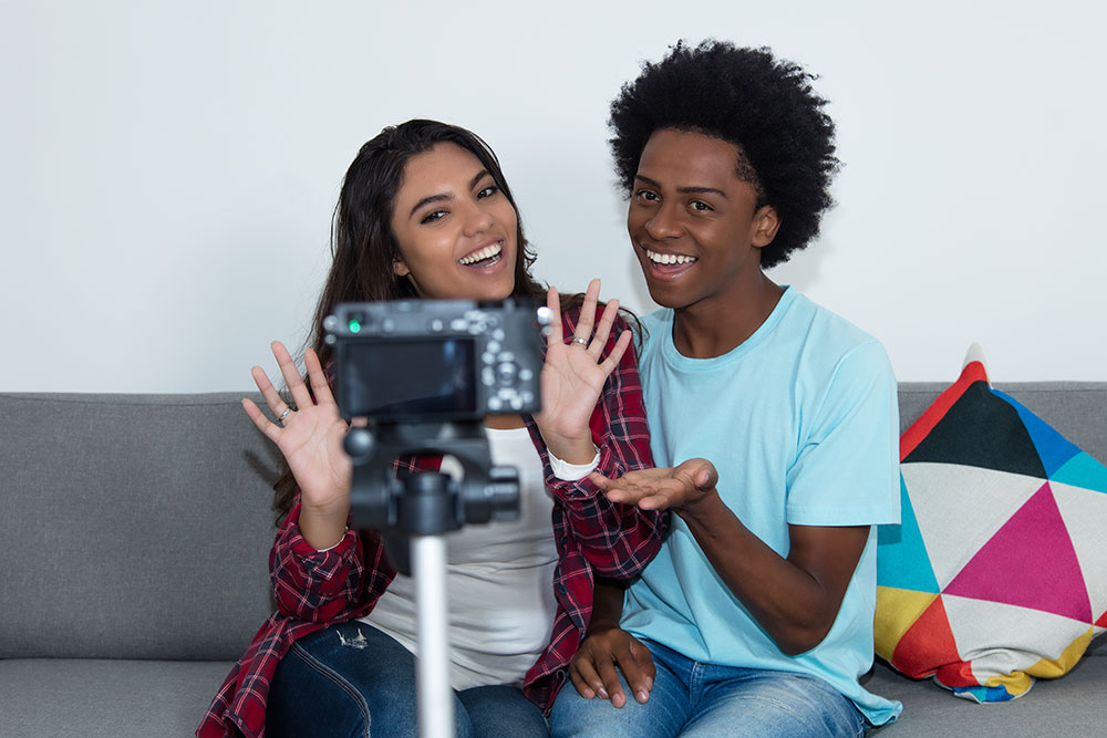 Image of a boy and a girl recording a video